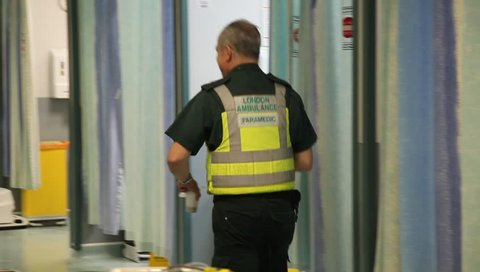 LONDON, UK - 2019: NHS A and E paramedic walks through ward