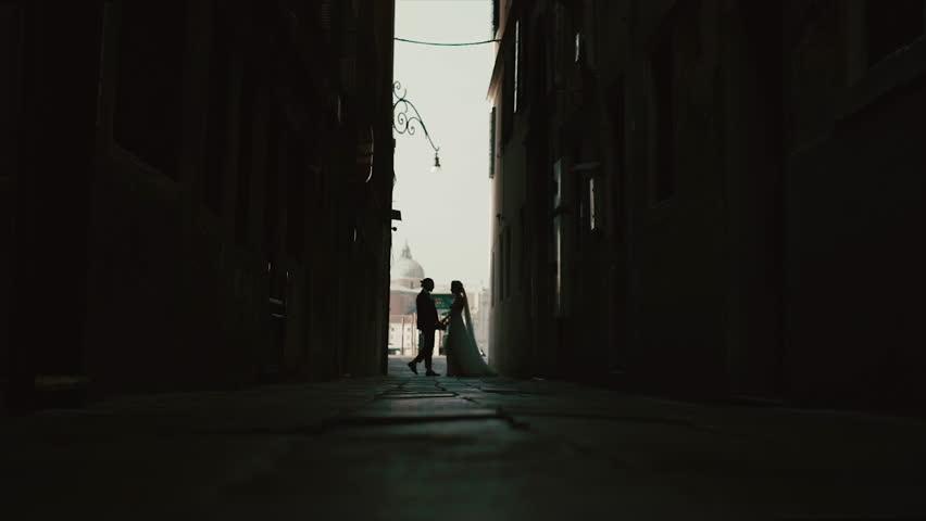 Venice. Newlyweds Are Kissing In A Dark Street.   Shutterstock HD Video #1027466639