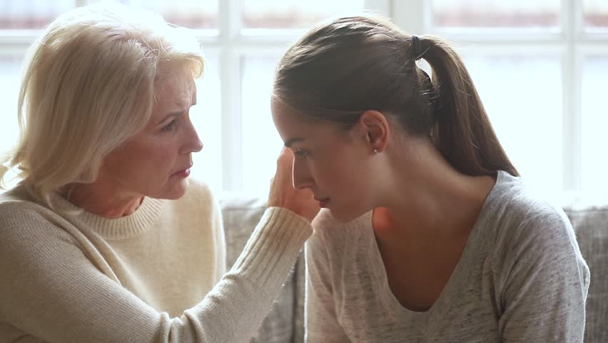 Understanding loving senior mother worried about upset young daughter having problem trust talk to caring old mom comforting consoling sad grown woman in trouble share problem with mature mum at home | Shutterstock HD Video #1027488509