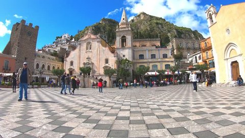 Taormina, Sicily - April 8th 2019: Fast motion time lapse video taken in the historical center of beautiful Sicilian city Taormina. The city is one of the major Italian tourist attractions.