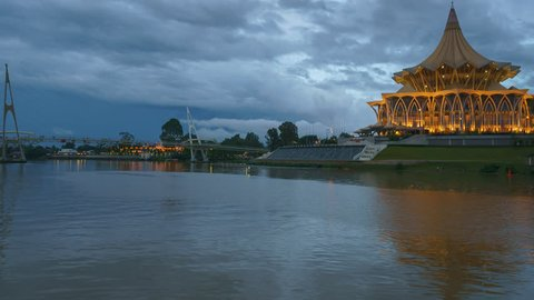 Sunset At Kuching Waterfront With Sarawak's State Legislative Assembly Building in the Background. Camera Pan Right