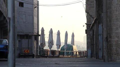 Empty street in Jaffa Israel during sunrise