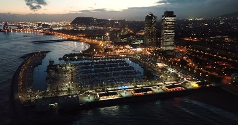 Aerial  view in Barcelona city with coast and  urban part of the city at night