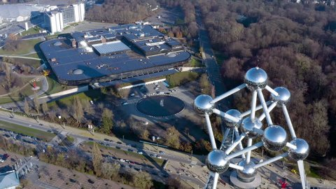 MARCH 03, 2019, Brussels, Belgium : Flying along World Fair Atomium in Brussels. Aerial view of atom sculpture Expo 58 is today the most popular tourist attraction and the symbol of Europe's Capital
