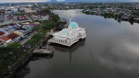 Kuching, Sarawak - April 2019. Cinematic aerial shot along the Sarawak River at Kuching Waterfront
