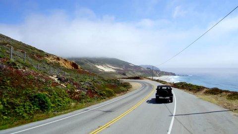 Big Sur, California / USA - July 17 2017: Jeep on Highway in Big Sur