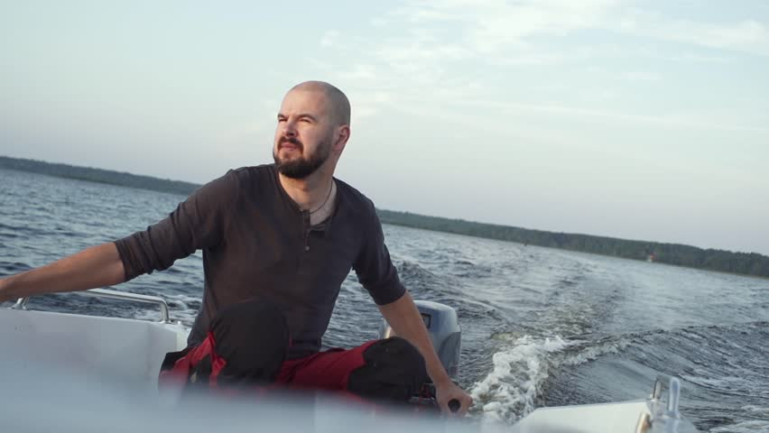 slow-motion man drive motorboat close up male rest, freedom, travel by water transport #1027870799