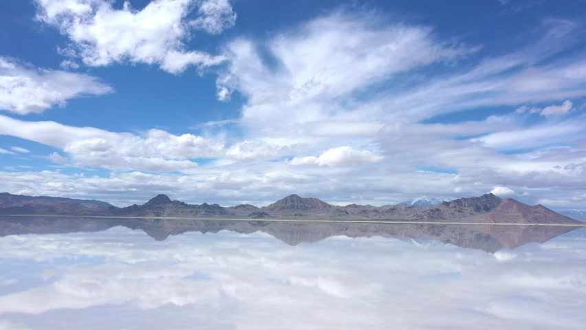 View of clouds reflecting in water over the Bonneville Salt Flats as water covers the landscape in Utah during Spring.