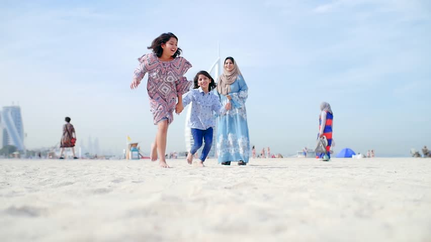 Mom and daughters spending time torgether at the park, playing at the playground and reading stories, Family moments in dubai | Shutterstock HD Video #1027983299