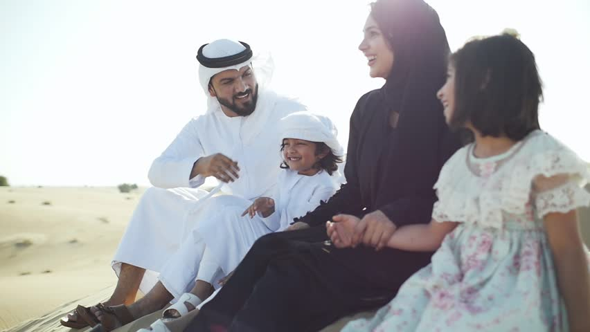 Happy muslim family spending weekend making safari in the dubai desert. Parents and kids having good time. lifestyle moments | Shutterstock HD Video #1027983779