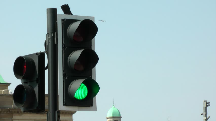 UK road crossing traffic lights from red, amber, green. filmed In busy city street. Medium shot. | Shutterstock HD Video #1027991039