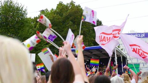Szczecin, Poland - 09 07 2018: Pride parade crowd waving rainbow flags supporting freedom tolerance and homosexuals