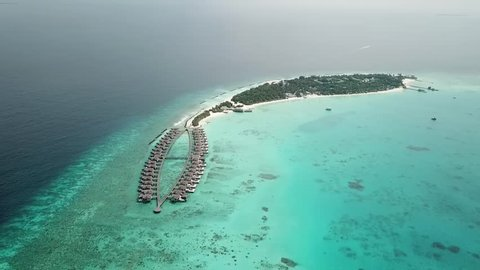 Aerial flying drone view of Maldives white sandy beach on sunny tropical paradise island