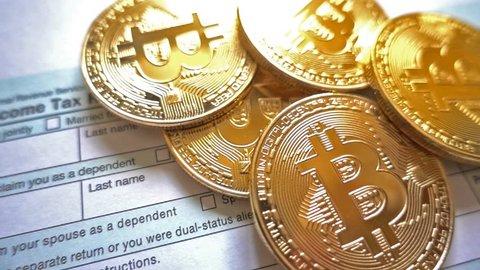 Tax refund concept. USA tax form 1040, pen, dollar bills, bit-coins.