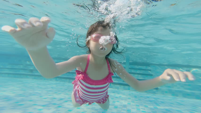 cute girl swim in the swimming pool
