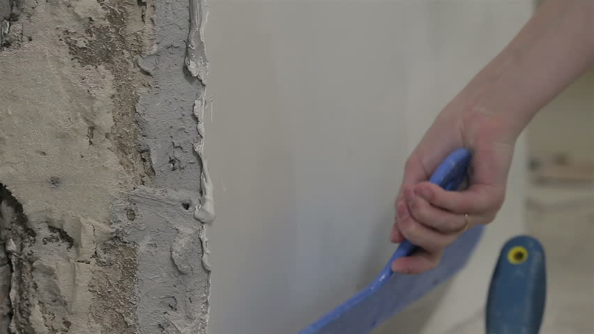 Worker applying putty on the wall | Shutterstock HD Video #1028016599