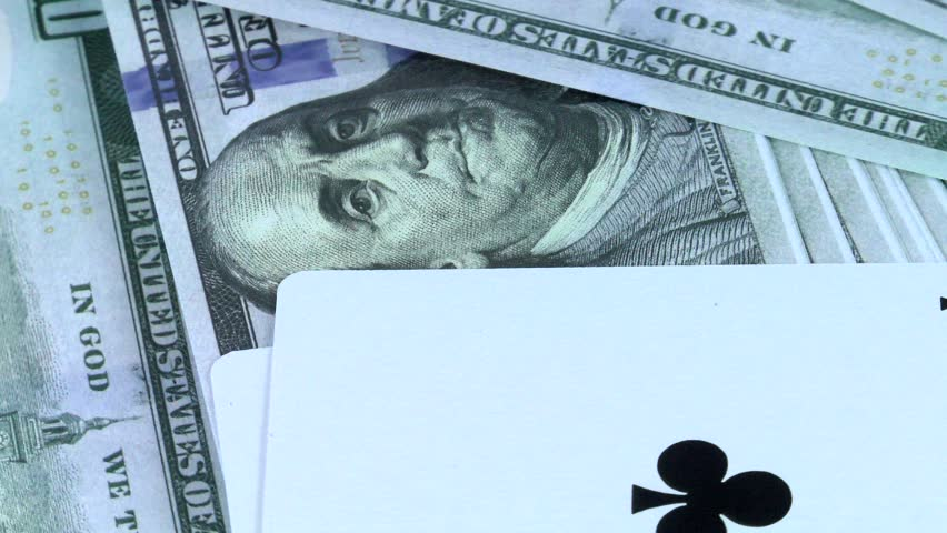 Rotating background from money of US dollars and a combination of two-double cards it is in poker close-up   Shutterstock HD Video #1028035079