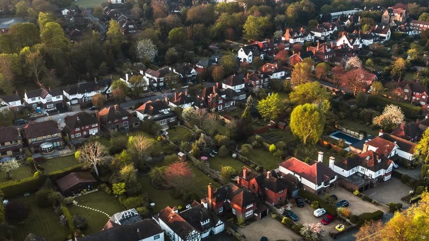 Aerial Shot of classic British housing estate, English houses and homes from above    Shutterstock HD Video #1028043419
