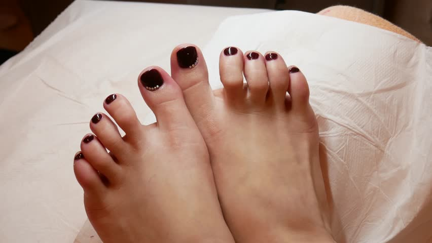 4k spa concept. Feet of a beautiful sexy woman after a pedicure. Close up. | Shutterstock HD Video #1028052119