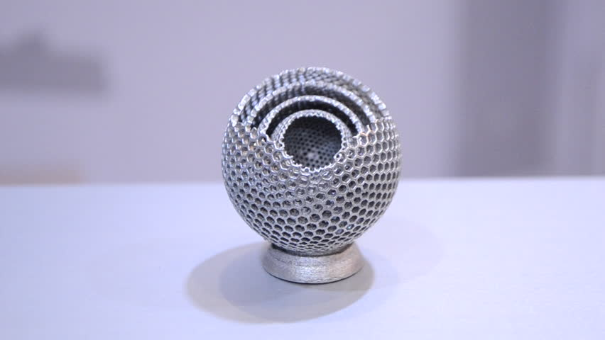 Object printed on metal 3d printer close-up. Object printed in laser sintering machine. Modern 3D printer printing from metal powder. Concept progressive additive DMLS, SLM, SLS 3d printing technology | Shutterstock HD Video #1028080019