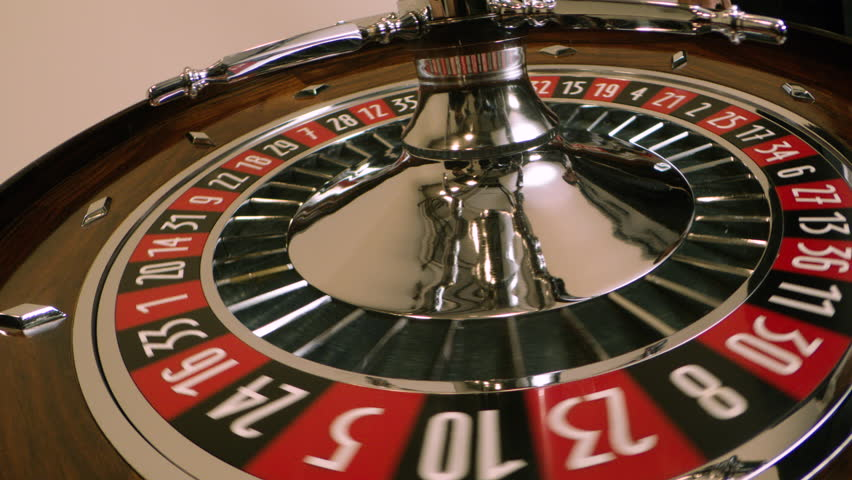 Roulette spinning wheel with ball in 27 red in slow motion | Shutterstock HD Video #1028099789