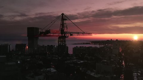 Construction Crane in the City at Sunset