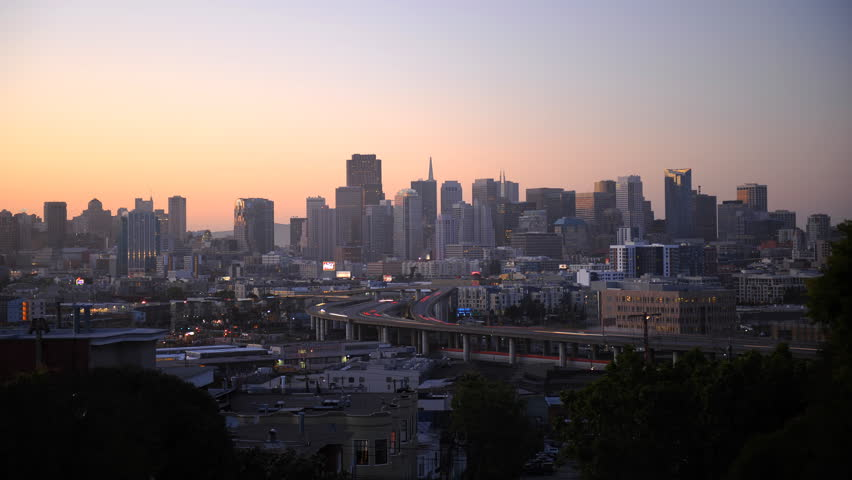 Timelapse Aerial View San Francisco Skyline Car Driving on Highway Dusk to Night