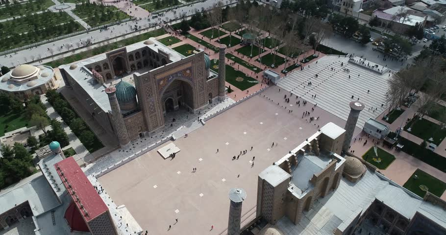 Aerial cityscape The Registan Square is the best place to discover the old Uzbek architecture and to enjoy the great mosaic decorations, Samarkand, Uzbekistan. | Shutterstock HD Video #1028121389