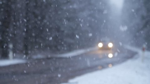 Movement of Vehicles in Difficult Weather Conditions. snowy day. Slow motion.