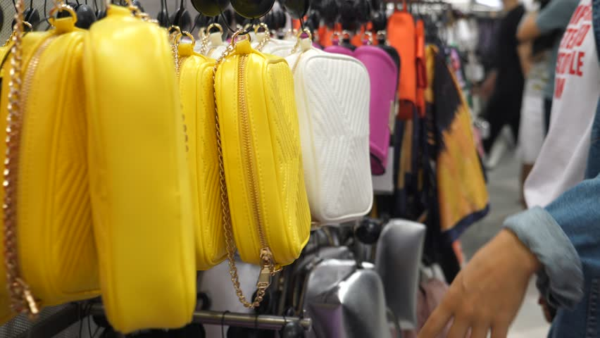 Woman Customer Choosing Colorful Bags In Store. Shopping Concept. | Shutterstock HD Video #1028136329