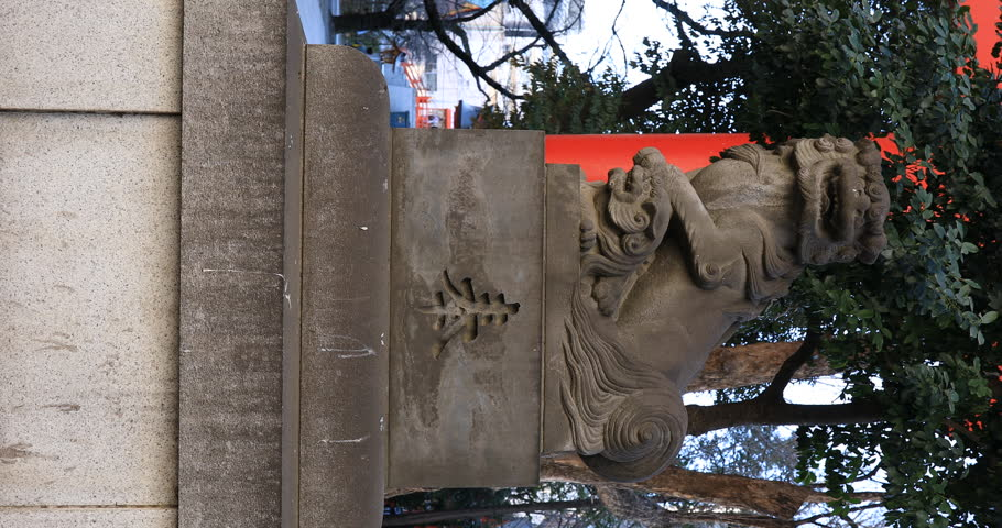 Statue guardian dog at the traditional shrine. Shinjuku district Tokyo Japan - 01.21.2019 : It is an old statue at the traditional shrine. camera : Canon EOS 5D mark4 | Shutterstock HD Video #1028153309