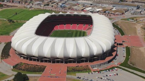 Port Elizabeth, South Africa - circa 2010s: Close clockwise aerial orbit of Nelson Mandela Bay Stadium. See entire roof structure and surrounding paved area, alongside North End Lake and parks