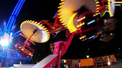 972-05 Carnival Ride At Night Spinning Wheel And Swing With Flashing Lights Loop