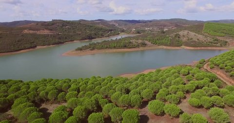 A lake near Albufeira, Portugal, with people SUP-ing