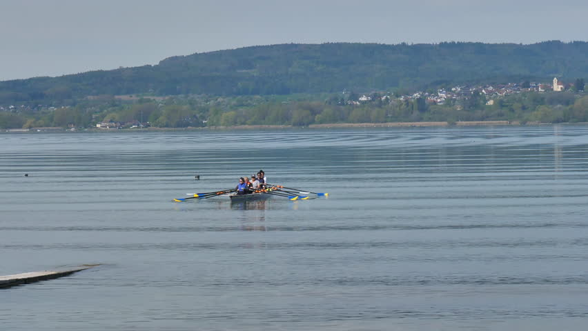 Watersport rowing boat at island Reichenau Bodensee. DE Germany. 20th April 2019 | Shutterstock HD Video #1028228489