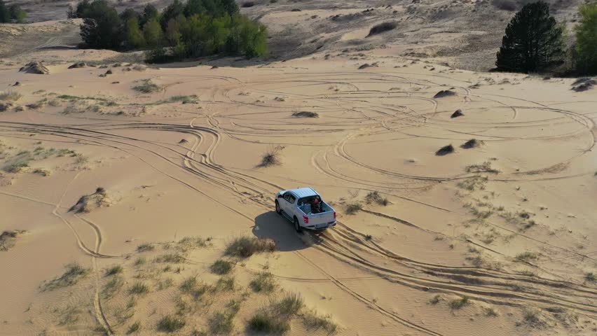 4k00:26Off road pickup truck driving on sand in desert. Aerial view