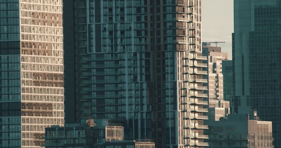 Establishing shot of skyscrapers. 4K filmic footage. #1028342729
