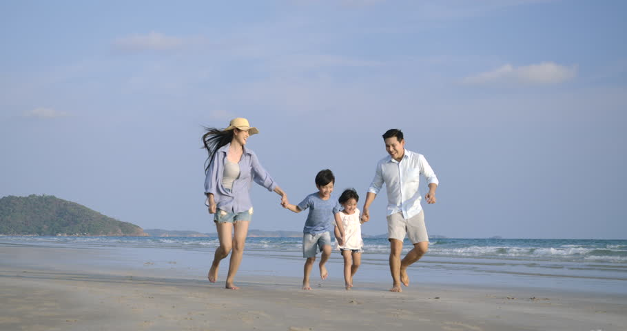 Asian family running with happy emotion at Beach together. Slow motion. Family, Holiday and Travel concept. | Shutterstock HD Video #1028374769