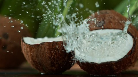 Super Slow Motion Shot of Water Splashing on Coconut at 4K.