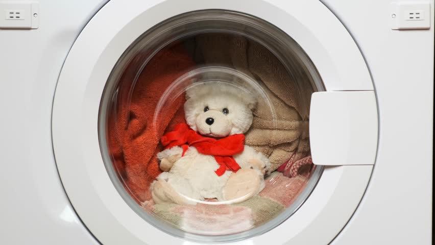 Teddy bear washes in the washing machine. Closeup. | Shutterstock HD Video #1028493989
