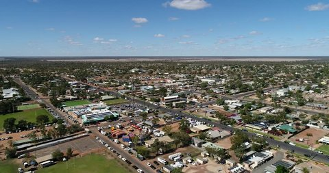 Streets of Lightning ridge opal mining town in outback Australia on a sunny dry day – aerial descending down to the ground.