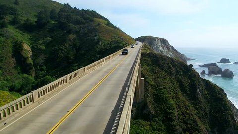 Monterey Bay, California / USA - August 2, 2016: Jeep Driving Through Big Sur California on Pacific Coast Highway, Aerial Drone Shot