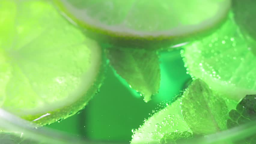 Refreshing Mojito cocktail slices of lime and mint | Shutterstock HD Video #1028854919