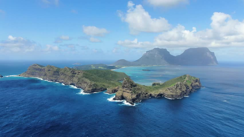 Stunning aerial 4k drone footage of Lord Howe Island, a pacific subtropical island in the Tasman Sea between Australia and New Zealand. Lord Howe belongs to New South Wales, Australia. #1028858069