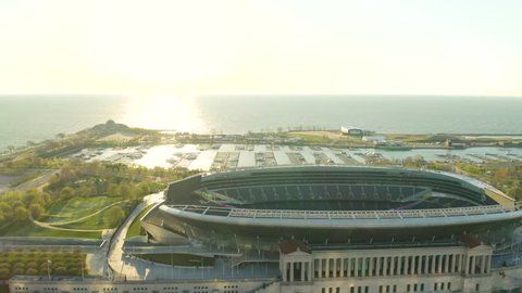 Chicago, Illinois / USA - April 28, 2019: Orbit Speed Ramp over Soldier Field during Sunrise [4k] [Editorial]