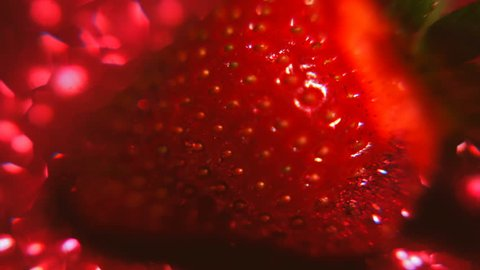 The taste of strawberries. Red light. Strawberry lubricant. Strawberry flavor. Fresh strawberries. Appetizing and delicious beautiful strawberries. Strawberry on shiny background