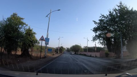 Pune, India - May 05 2019: Time lapse of driving through the streets of Pune India.