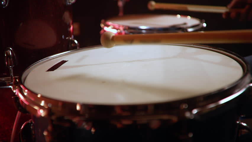 Drummer, jazz lesson , percussion drumsticks , slow drumroll on a snare  a rehearsal studio on a red drums , low key, close-up | Shutterstock HD Video #1028916299