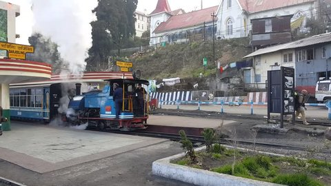 Darjeeling Station, India - March 2019: UNESCO maintained heritage toy train himalayan queen pulled by steam engine in the Northern railway is used for joyride between Darjeeling and Ghoom station.