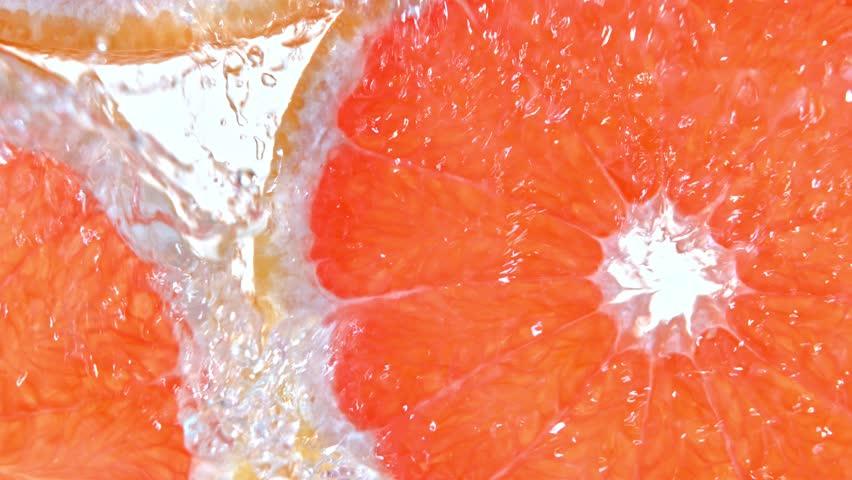 Super Slow Motion Shot of Splashing Water to Grapefruit Slices at 1000fps. #1028955329